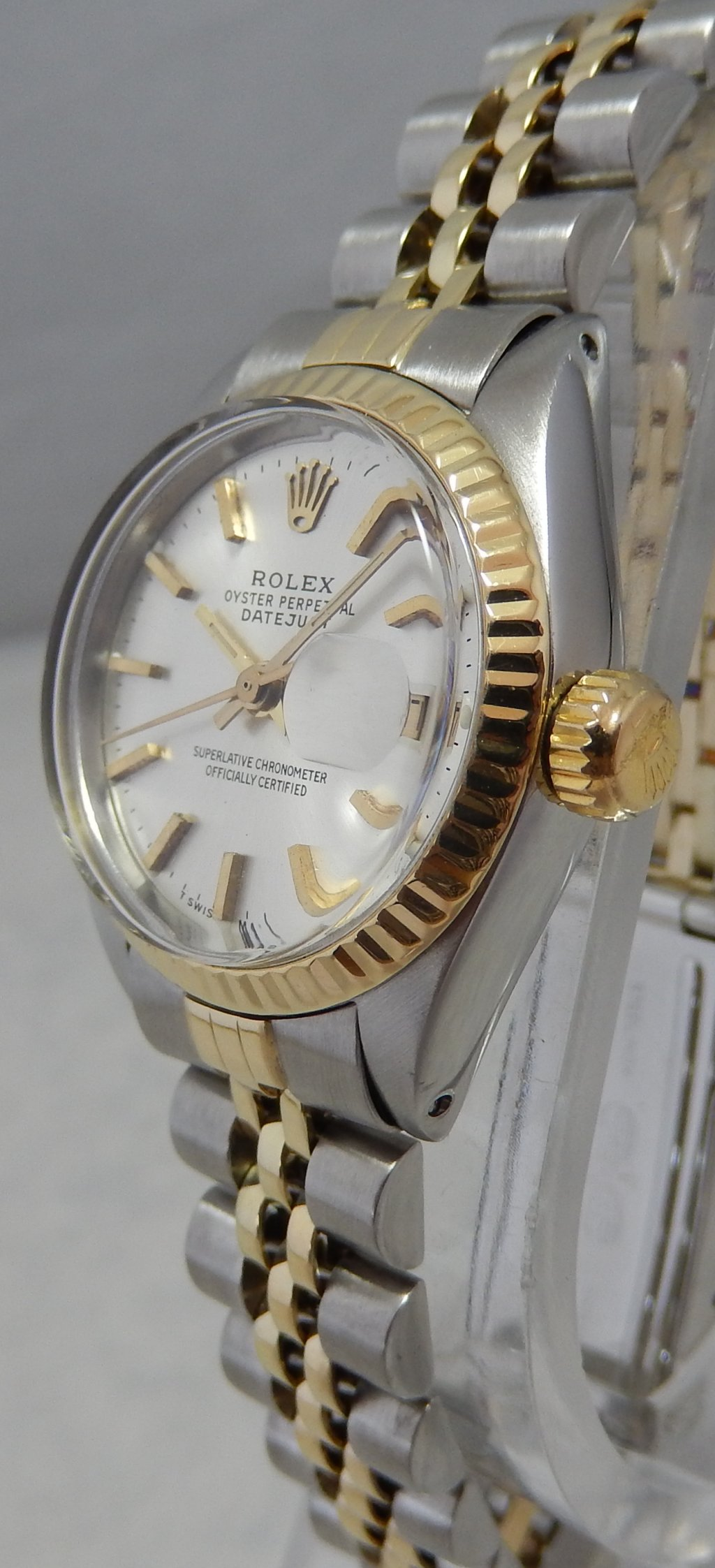 743dd6cd2e It is the Rolex Oyster Perpetual Datejust stainless steel and 14k yellow  gold two toned ladies watch with a beautiful silver colored ...